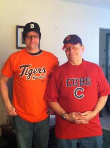 Dad and I exchanging gifts. He did the right thing and raised me a Tigers fan, despite his Cubs crush.